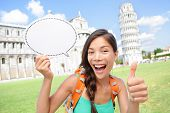 Travel tourist girl showing sign in Pisa, Italy. Young woman traveling holding speech bubble copy sp