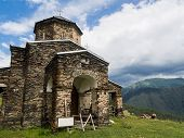 stock photo of greater  - Sameba church in Shenako villgae in Greater Caucasus - JPG