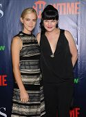 LOS ANGELES - JUL 17:  Emily Wickersham & Pauley Perrette arrives to the CBS-CW-Showtime Summer TCA Press Tour 2014  on July7, 2014 in West Hollywood, CA.