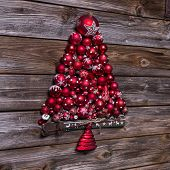 Red Christmas Tree Of Balls On Wooden Vintage Background.