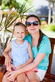 Happy mother and her adorable little daughter outdoors