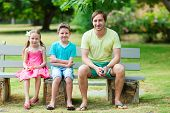 Father and kids outdoor on summer day