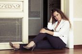 Beautiful fashion woman sitting on the floor at apartment