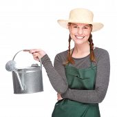stock photo of pinner  - Full isolated portrait of a beautiful caucasian gardener with watering can - JPG