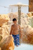 Boy In Tunisian Aquapark Resort Under Shower