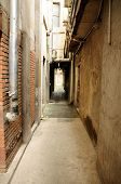 A narrow industrial alley way