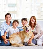 Portrait of happy family with a dog
