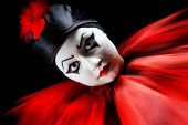 Flashing portrait in red and black of a mime pierrot clown
