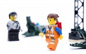 Ankara, Turkey - March 15, 2014 : Studio shot of Lego Movie bad cop trying to catch Emmet isolated o
