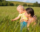 Baby and mom in wheat field