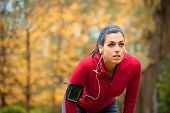 image of breath taking  - Tired female runner taking a break - JPG