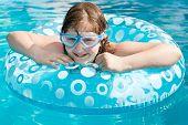 Girl In Swim Goggle On Swimming Circle