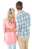 Attractive couple standing and looking on white background