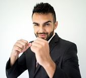Portrait of attractive man posing with fists on white background