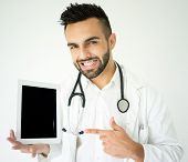 Attractive modern doctor with tablet