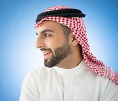 Profile of Arabic businessman on blue wall