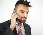 Portrait of attractive man calling on cell phone