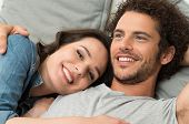 Close up Of Happy Loving Couple Lying On Couch