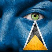 Saint Lucian Flag Painted On A Man's Face