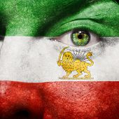 Flag Painted On Face With Green Eye To Show Iran Support