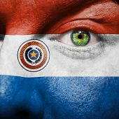 Flag Painted On Face With Green Eye To Show Paraguay Support