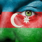 Flag Painted On Face With Green Eye To Show Azerbaijan Support