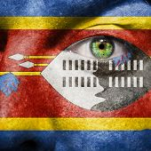 Flag Painted On Face With Green Eye To Show Swaziland Support