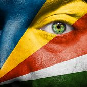 Flag Painted On Face With Green Eye To Show Seychelles Support