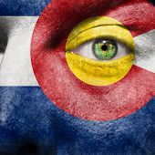 Flag Painted On Face With Green Eye To Show Colorado Support
