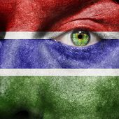 Flag Painted On Face With Green Eye To Show Gambia Support