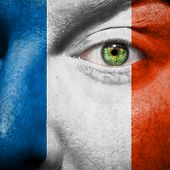 Flag Painted On Face With Green Eye To Show France Support