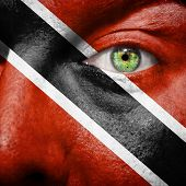 Flag Painted On Face With Green Eye To Show Trinidad And Tobago Support