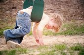 stock photo of swingset  - Young boy laying on a swing - JPG