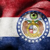Flag Painted On Face With Green Eye To Show Missouri Support