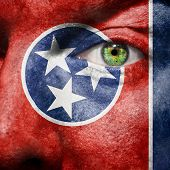 Flag Painted On Face With Green Eye To Show Tennessee Support