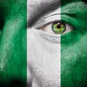 Nigerian Flag Painted On A Man's Face