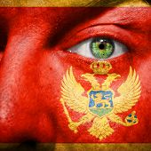 Montenegro Flag Painted On A Man's Face