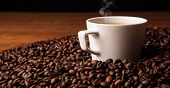 Cup Of Black Coffee With Roasted Coffe Beans