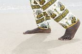 Man walking on a white sand beach