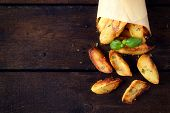 stock photo of baked potato  - Baked potatoes on the wooden table from above with blank space on left side - JPG
