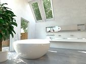 Modern bathroom interior with a white freestanding central oval bathtub and a wall-mounted double vanity unit with glass windows and skylights with a view of green trees