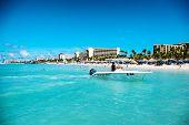 PALM BEACH, ARUBA - CIRCA DECEMBER 2013 - Scenic view across a calm blue ocean along the coastline o