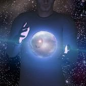 Man holds planet and space in sphere between his hands