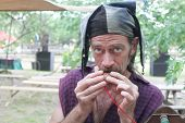 MUSKOGEE, OK - MAY 24: Whistle and flute maker shows off his newly crafted item at the Oklahoma 19th