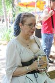 MUSKOGEE, OK - MAY 24: Woman enjoys a drink during the Oklahoma 19th annual Renaissance Festival on