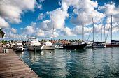 ORANJESTAD, ARUBA - CIRCA DECEMBER 2013 - Scenic view of a variety of pleasure boats, motorboats and yachts moored in a marine harbor in circa December 2013 Oranjestad, Aruba