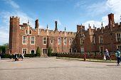 HAMPTON COURT, UK - AUGUST 03, 2014 - West Front & Main Entrance of Hampton Court Palace near London