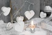 Christmas Candle In White With Hearts, Wood And Snow For Decoration