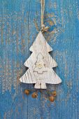 Handmade Christmas Decoration - Tree Carved On A Blue Wooden Christmas Background