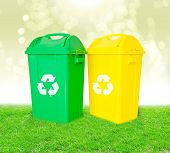 Green And Yellow Plastic Trash Recycling Container With Recycle Sign Ecology Concept,